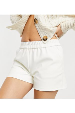Miss Selfridge Faux-leather runner shorts in cream