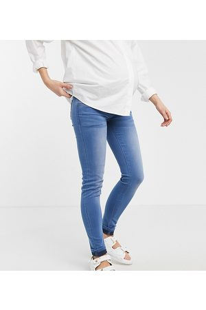 Mama Licious Mamalicious Maternity over the bump skinny jeans in blue