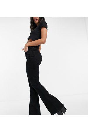 Reclaimed Inspired 79 super stretch flare jean in clean black
