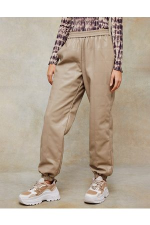 Topshop Faux-leather trackies in beige
