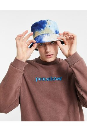 Vintage Supply Tie dye corduroy bucket hat in blue