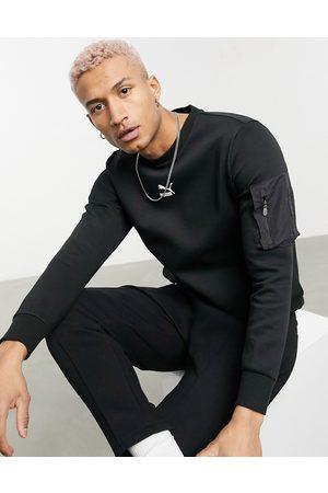 PUMA Avenir MA1 logo sweatshirt in black