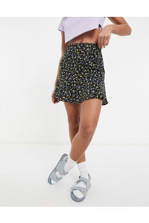 Motel Mini flippy skirt in black floral co-ord-Multi