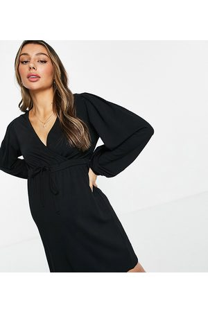 Mama Licious Mamalicious Maternity mini smock dress with wrap front and puff sleeve in black