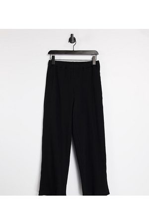 COLLUSION Unisex relaxed trackies in heavy rib in black co-ord