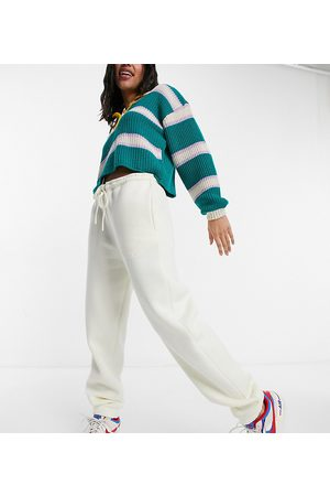 COLLUSION Unisex oversized trackies with embroidered logo in ecru co-ord-White