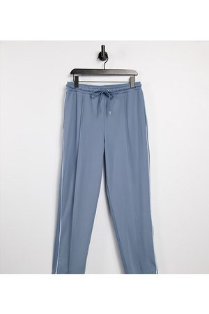 COLLUSION Unisex slim tapered trackies in poly tricot in dusty blue co-ord