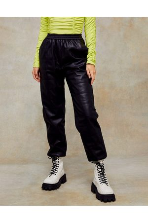 Topshop Faux leather quilted trackies in black