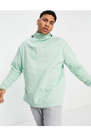 ASOS Organic oversized sweatshirt with rib funnel-neck and toggle-Green