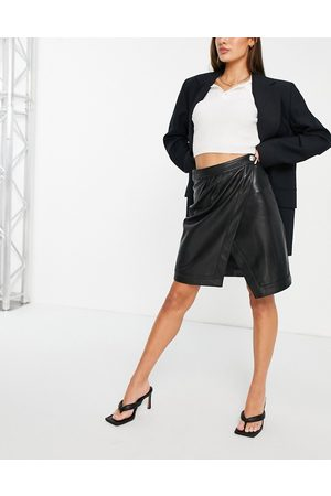 Morgan Faux leather wrap skirt in black