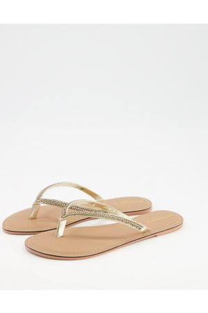 Accessorize Embellished thong flip flops in gold