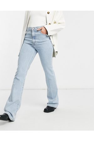 J Brand Super high-rise runway body shaping boot cut jeans in light wash blue