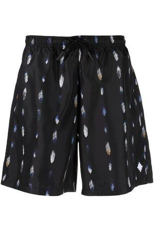 MARCELO BURLON Men Board Shorts - Feather-print swim shorts