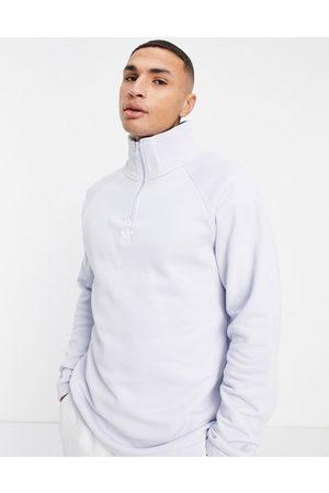 adidas Trefoil 1/4 zip sweatshirt in pale blue