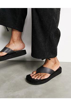 ASOS DESIGN Flip flops on angular wedge sole in black