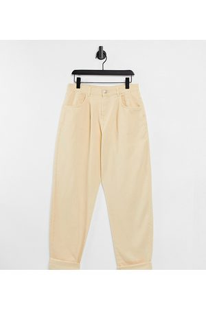 Reclaimed Vintage Inspired The 83 unisex relaxed jean in pale yellow