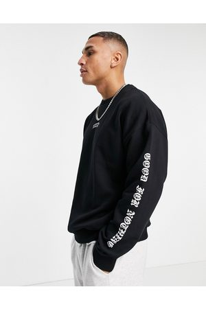 Good For Nothing Sweatshirt in black with chest and arm logo print