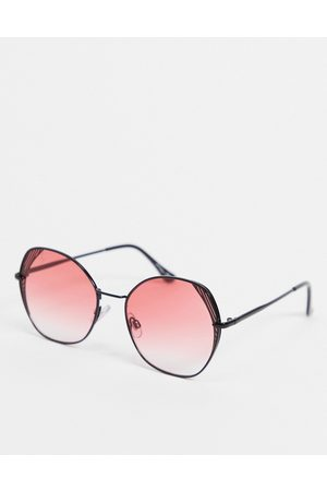 Jeepers Peepers Oversized angled sunglasses in black with pink lens and lens detail