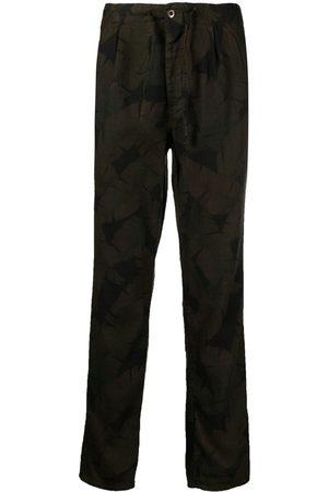 Incotex Leaf print carrot-fit trousers