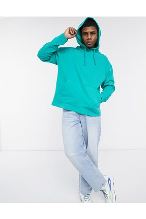ASOS Oversized hoodie in washed green-Blue