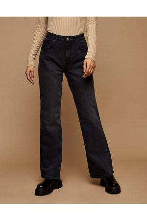 Topshop Relaxed flare jeans in wash black denim