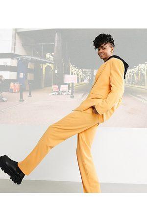 COLLUSION Unisex straight leg pants in orange