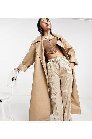 COLLUSION Longline faux leather coat in ecru-Green