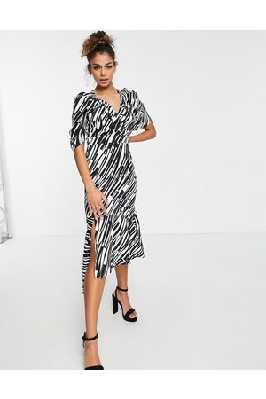 Liquorish Midi dress with peplum hem in zebra print-Black
