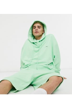 COLLUSION Oversized cropped hoodie in green co-ord