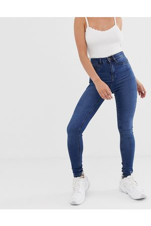 Noisy May Callie high waist skinny jeans in mid blue wash