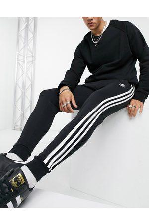 adidas Adicolor three stripe skinny track pants in black