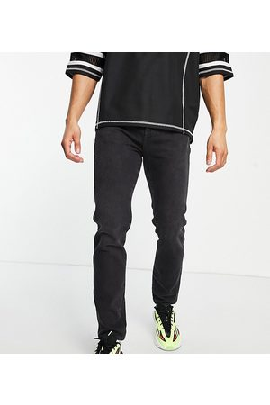 COLLUSION X003 tapered jeans in washed black