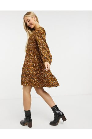 Y.A.S Mini skater dress with v-neck in mustard floral-Multi