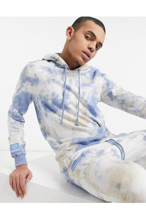 ASOS ASOS Daysocial co-ord hoodie in brown and blue tie- dye with logo print