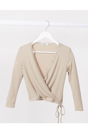 Stradivarius Wrap long sleeve top with lace detail in beige-Neutral
