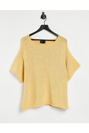 ASOS Oversized textured T-shirt in off pale yellow