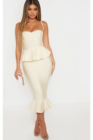 PRETTYLITTLETHING Cream Strappy Peplum Frill Hem Bandage Midi Dress
