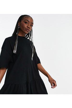 ASOS ASOS DESIGN Tall oversized T-shirt dress with frill hem in black