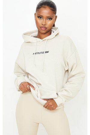 PRETTYLITTLETHING Sand Embroidered Slogan Pocket Hoodie