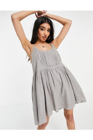 ASOS Mini cami smock sundress with pintucks and crochet lace in washed grey