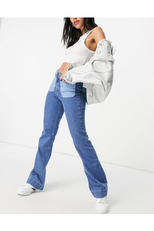 Wrangler Flared jeans with patch pockets in blue