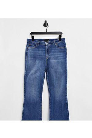 ASOS ASOS DESIGN Petite high rise 'Y2K' stretch flare jeans in vintage midwash-Blue