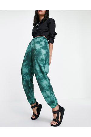 ASOS DESIGN Tie-dye trackies in green