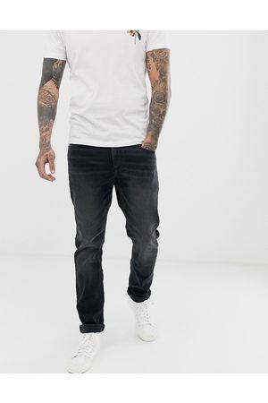 ASOS DESIGN Stretch slim jeans in washed black