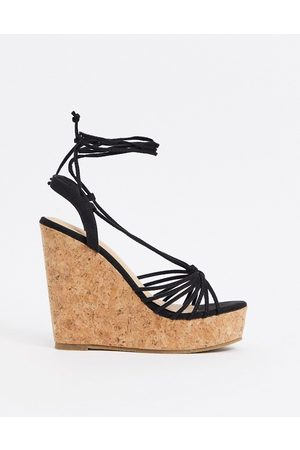 Truffle Collection Tie leg glam wedges in black