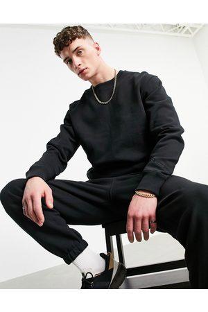adidas X Pharrell Williams premium sweatshirt in black