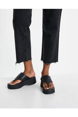 Kaltur Leather flatform thongs in black