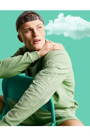 ASOS Outfit Sets - Co-ord relaxed sweatshirt in reverse loopback with logo arm print in green