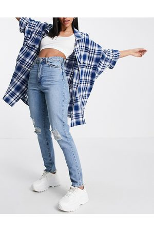 Dr Denim Nora high rise mom jeans with ripped knees in blue