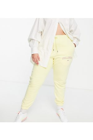 COLLUSION Joggers - Plus exclusive varsity print skinny trackies in yellow